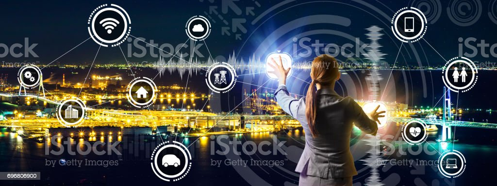 smart city panorama and business person controlling futuristic GUI, abstract image visual stock photo