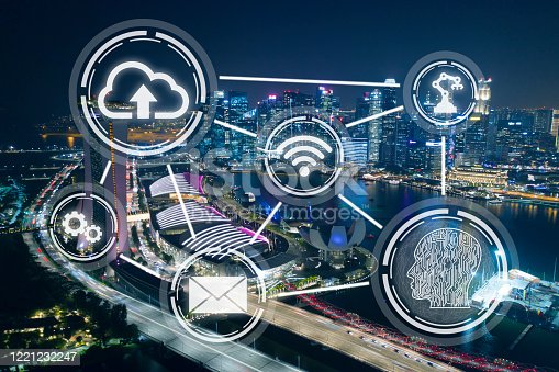 861165648 istock photo Smart city, wireless technology abstract on Singapore financial district background at night 1221232247
