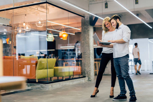 smart colleagues brainstorming in the office - cool attitude stock photos and pictures