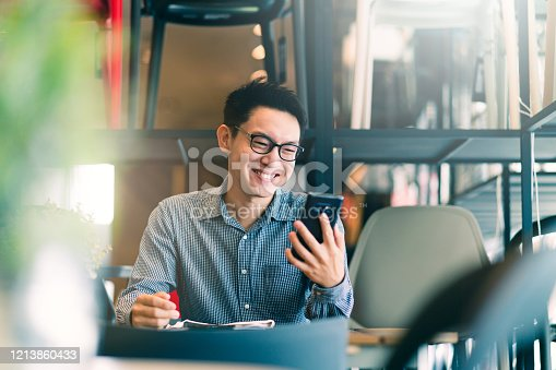 istock smart confidence asian startup entrepreneur business owner businessman smile hand use smartphone woking in office background 1213860433