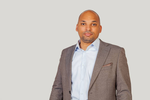 A smart confident black African-American young man, in a shirt and a jacket, a smart look, confident in his success stock photo