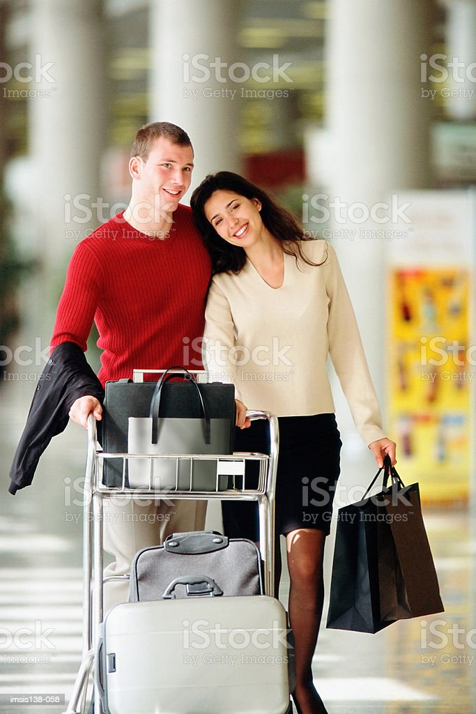 Smart couple at the airport royalty-free stock photo