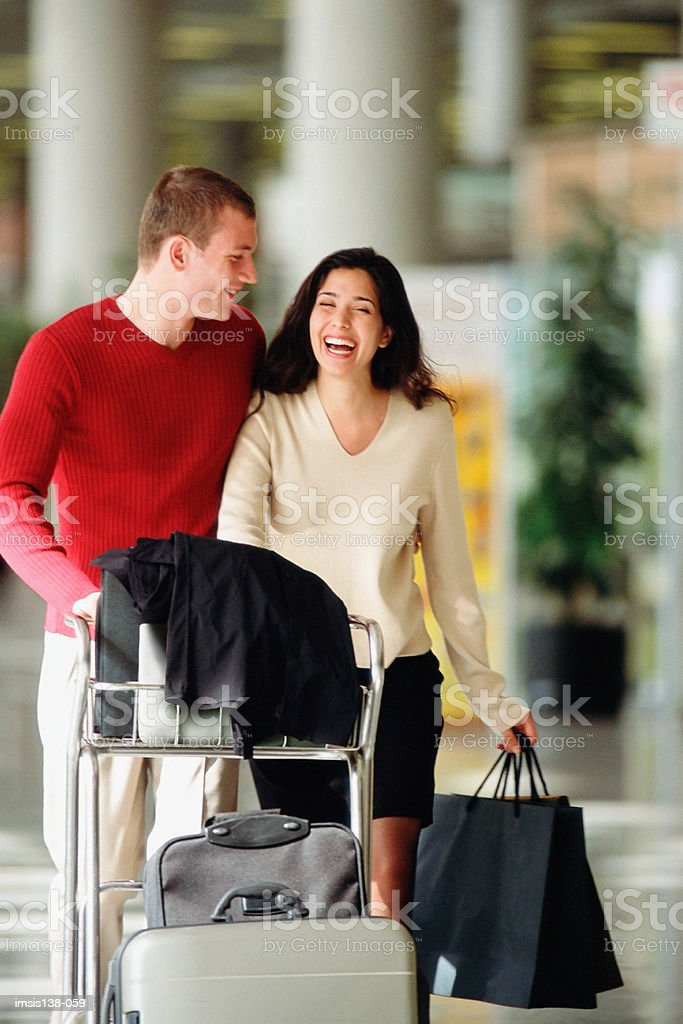 Smart couple at the airport stock photo