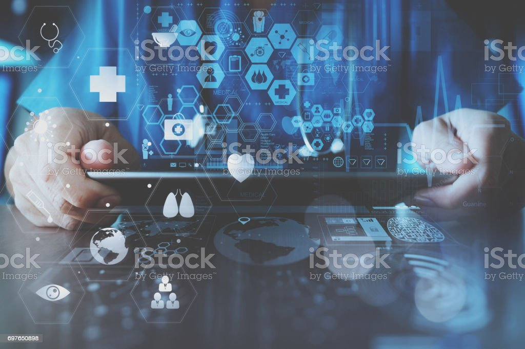 smart doctor hand working with modern laptop computer in modern office with virtual icon diagram - foto stock