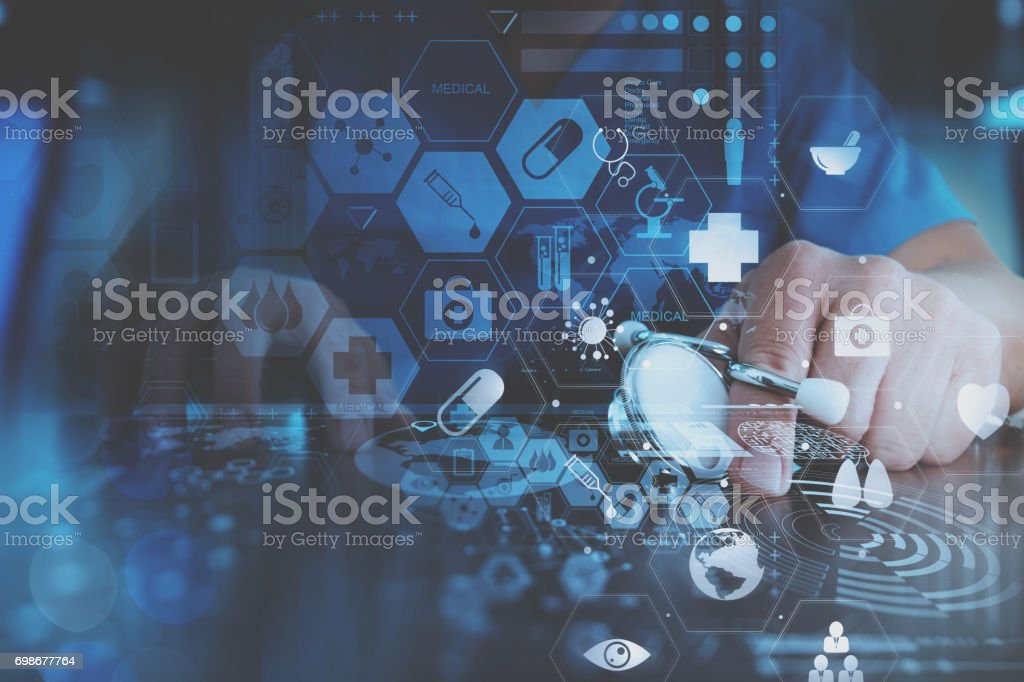 smart doctor hand working with modern laptop computer in modern office with virtual icon diagram stock photo