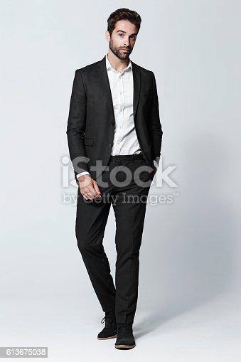 Smart dressed man in black suit, portrait