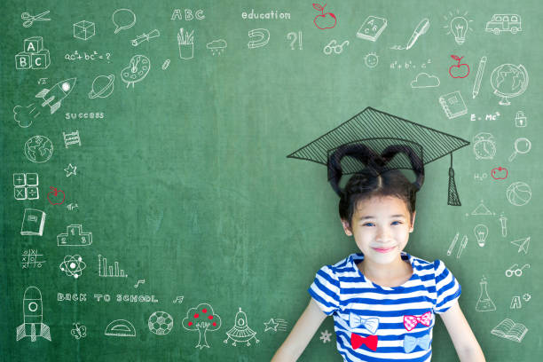 smart educated school kid student with graduation hat doodle on chalkboard  for children's education success and scholarship concept - teachers day stock photos and pictures