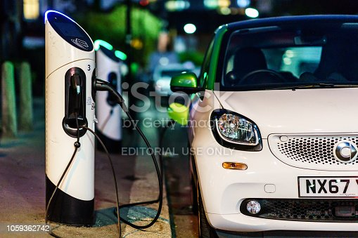London, UK - October 20th, 2018: Smart electric car charging in the London Street st night.