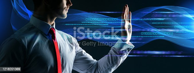 1079974636 istock photo smart elegant caucasian businessman with smarthpone and virtual graphic technology ideas concept dark background 1218201369