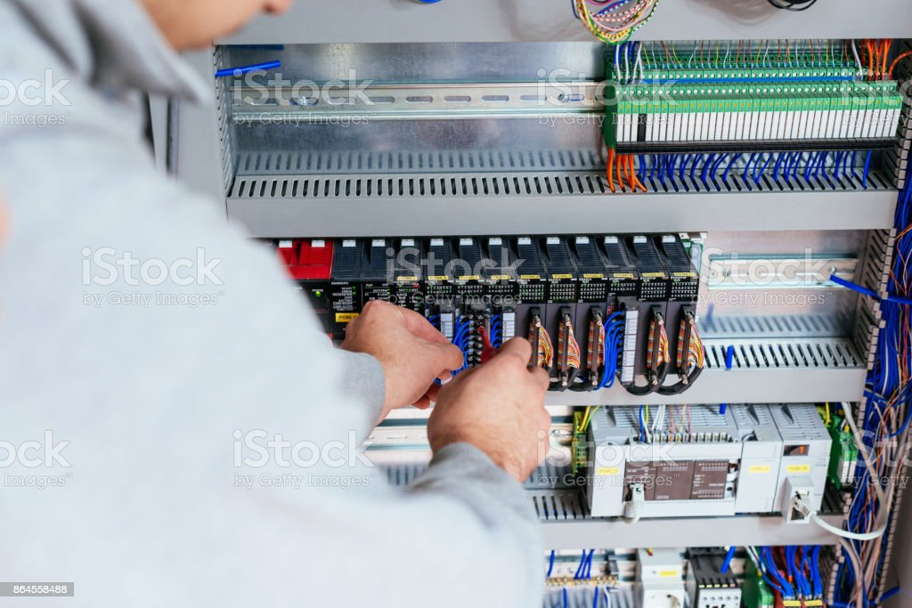 Smart engineer working on production line in factory stock photo