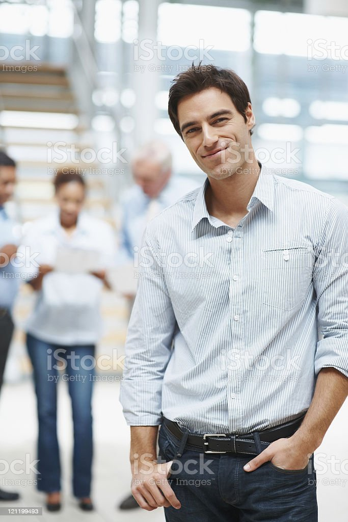 Smart executive with colleagues in discussion at the background royalty-free stock photo