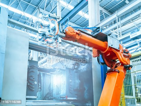874298574 istock photo Smart factory industry 4.0 concept from robotic arm machine tool for production line of injection molding process at vehicle industrial factory. 1167116288