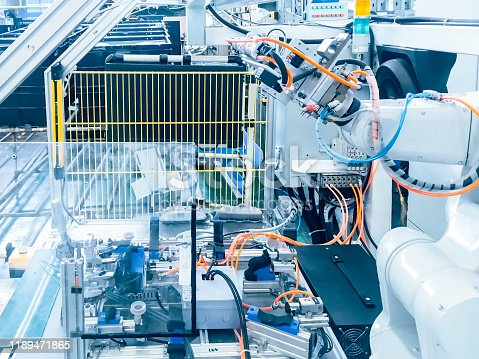 874298574 istock photo Smart factory industry 4.0 concept from robotic arm machine tool for production line of injection molding process at vehicle industrial factory. 1189471865