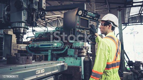 istock Smart factory worker using machine in factory workshop 1278060577