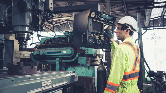 Smart factory worker using machine in factory workshop . Industry and engineering concept.