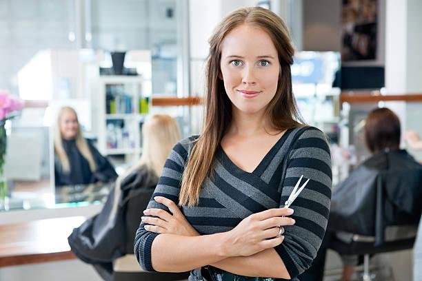 Smart Female Hairdresser Holding Scissor stock photo