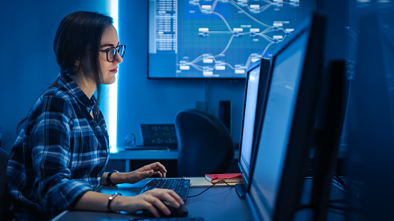 Smart Female It Engineer Programer Working On Desktop Comuter Software Development Coding Web Design Database Architecture Young Girl Stem Graduate Working Stock Photo - Download Image Now
