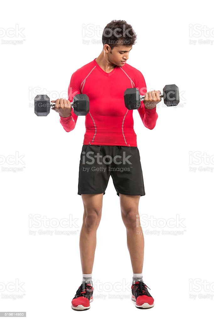 Smart fit young man doing out with dumbbells stock photo