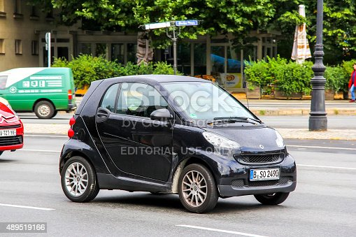Berlin, Germany- September 10, 2013: Compact motor car Smart Fortwo drives at the city street.