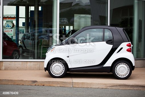 Halifax, Nova Scotia, Canada - August 7, 2011: Smart Fortwo vehicle in front of car dealership showroom.  The Smart fortwo has a 1.0-litre 70hp engine. First introduced in 1998, the model received a facelift for the 2002 model year.