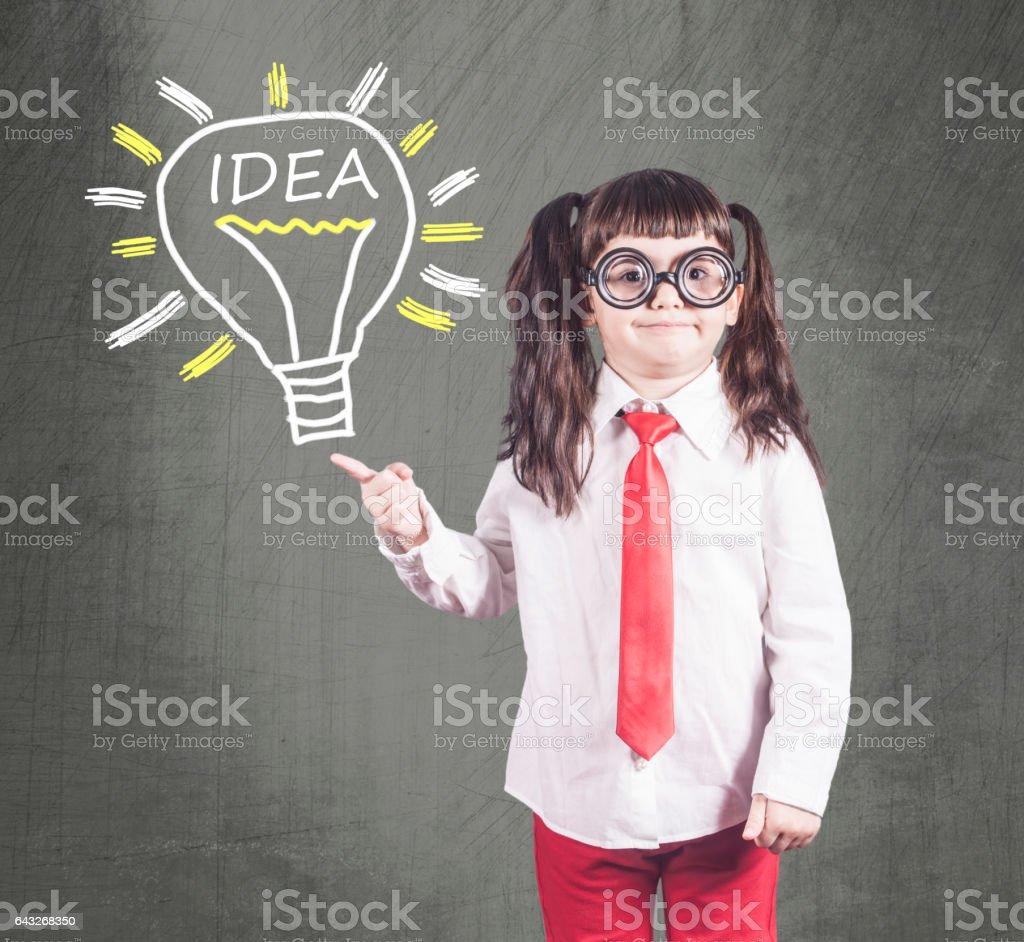 Smart girl having an idea stock photo