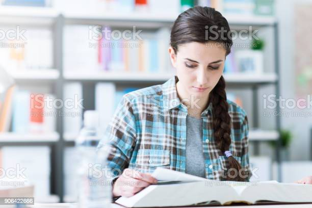Teenager Girl Doing Her Homework Stock Photo High-Res