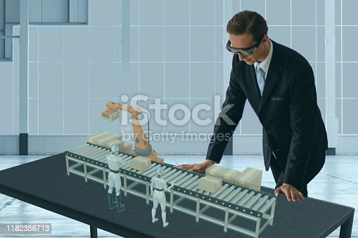 1150202727 istock photo smart glasses device concept, engineer use augmented mixed virtual reality technology to look at the industrial process line, for management ,predict the efficiency, yield, oee, data, 1182356713