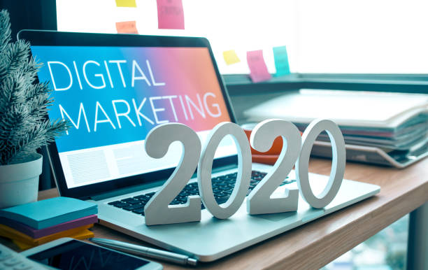 2020, smart goal concepts with mock up text number on computer laptop on desk table and window office background stock photo