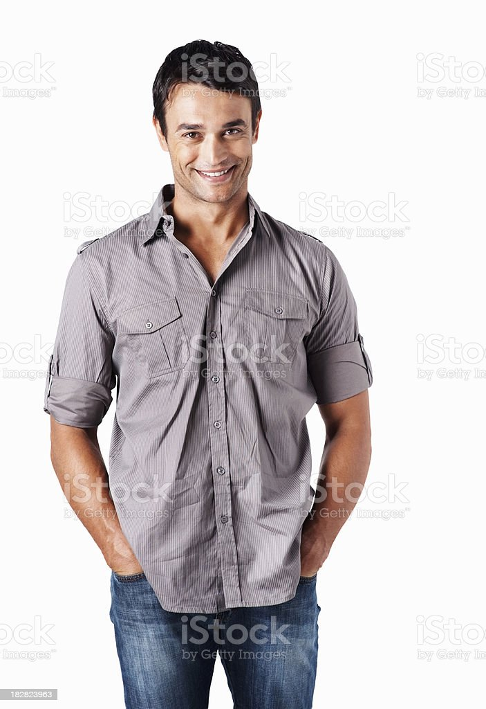 Smart guy standing with hands in pockets against white royalty-free stock photo