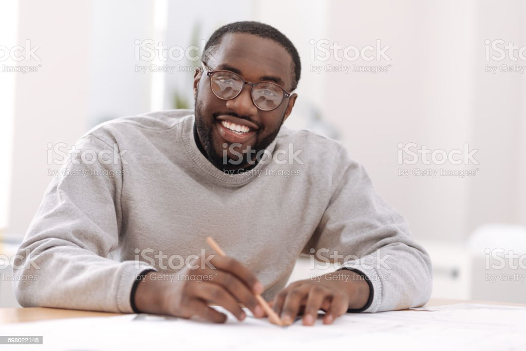 Smart happy architect looking at you stock photo