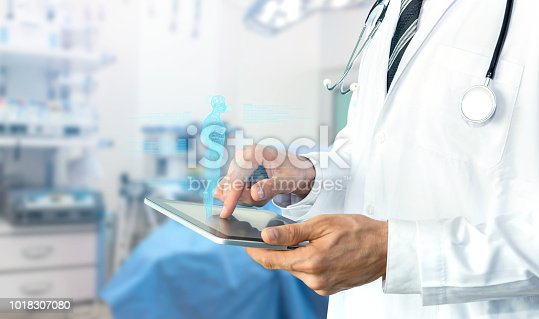 istock Smart health care internet of things and hospital automation management , Artificial intelligence hologram robot adviser technology concept. Doctor with Stethoscope using tablet for remote monitoring. 1018307080