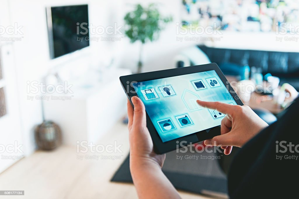 Smart home automation and control with digital tablet stock photo