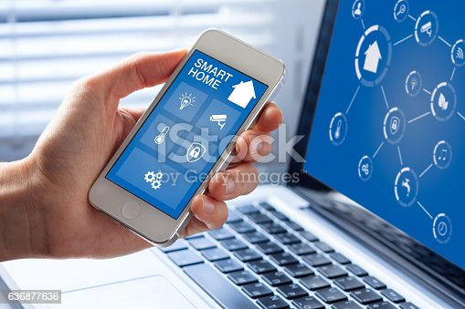 istock Smart home automation app interface on mobile phone, artificial intelligence 636877636