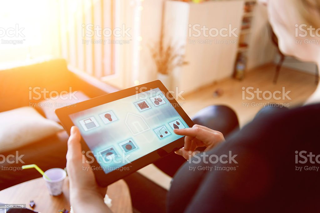 Smart home automation controlled with tablet and app bildbanksfoto