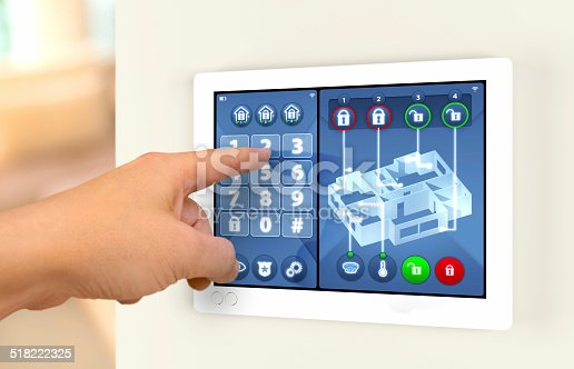istock Smart home automation: engaging house alarm security system 518222325