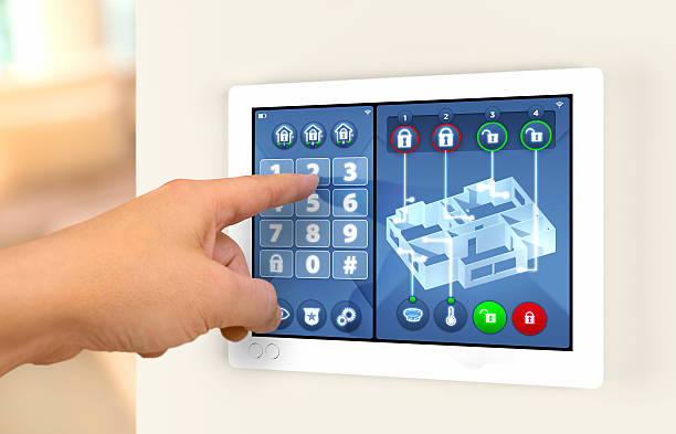 smart home automation: engaging house alarm security system - alarm stock photos and pictures