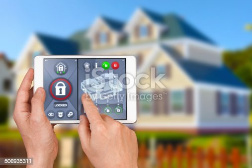 475693130 istock photo Smart home automation: locking house door with security remote control 506935311