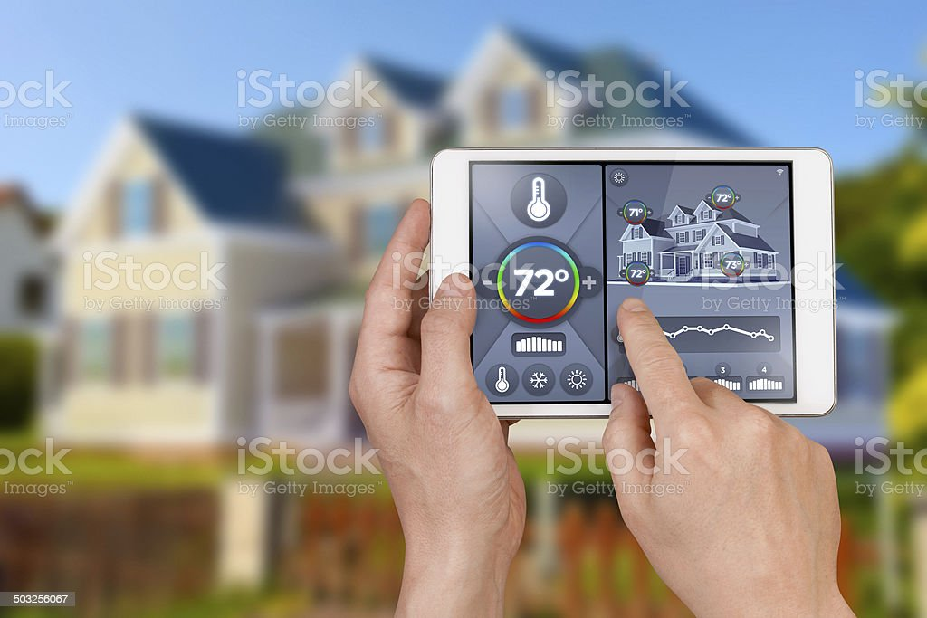 Smart home automation: remote controlling house temperature, Fahrenheit degrees stock photo
