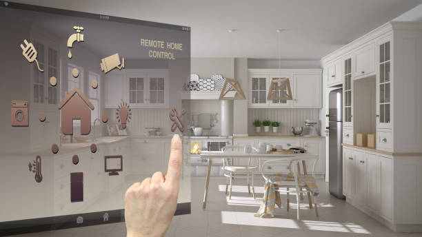 Smart home control concept, hand controlling digital interface from mobile app. Background showing scandinavian classic kitchen with dining table and chairs, architecture interior design stock photo
