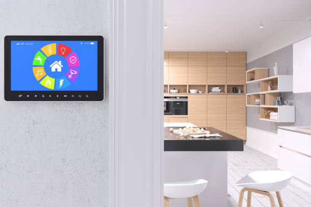 Smart Home Control with modern kitchen Smart Home Control with modern kitchen smart thermostat stock pictures, royalty-free photos & images