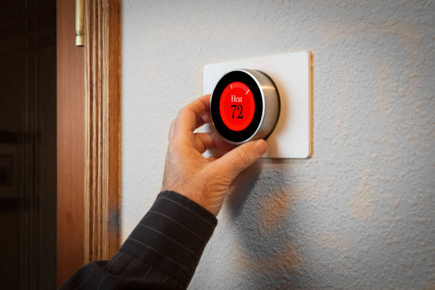 Smart Home: Digital thermostat heating and cooling automation system stock photo