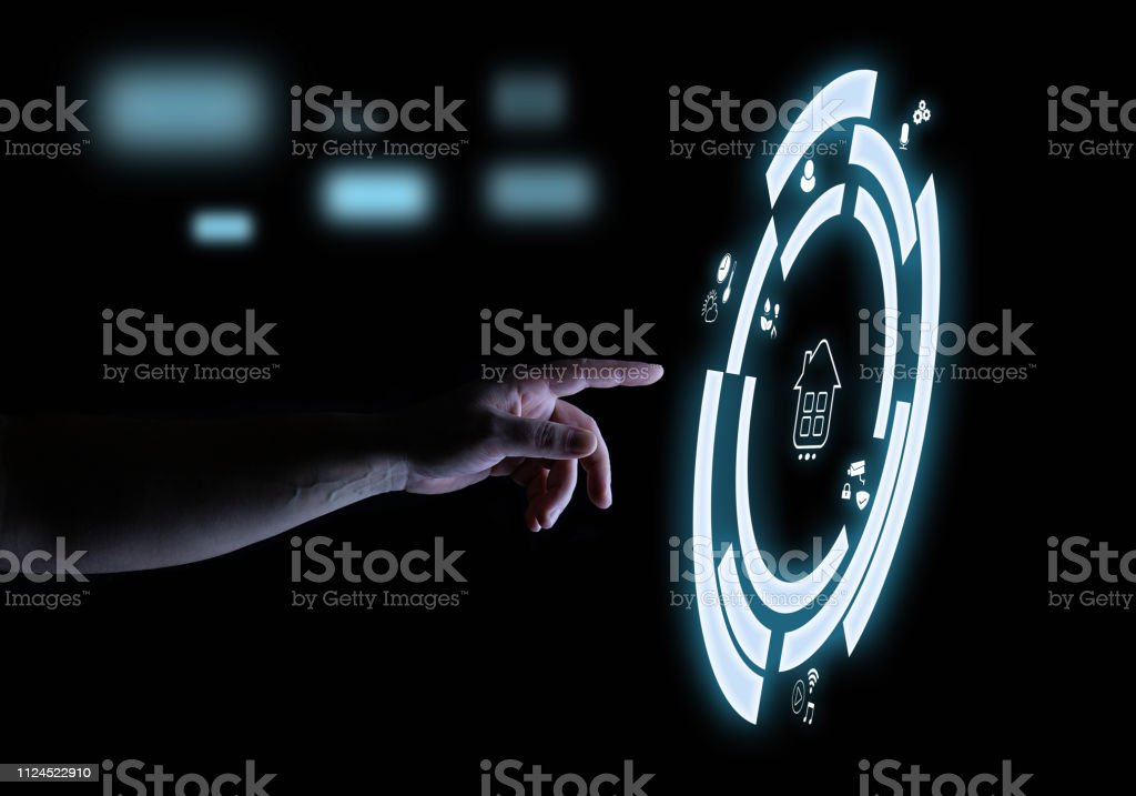 Smart Home Digital Touch Hologram User Interface Technology Concept Hand with Smart Home Digital Touch Hologram User Interface Technology Concept in Dark Abstract Stock Photo