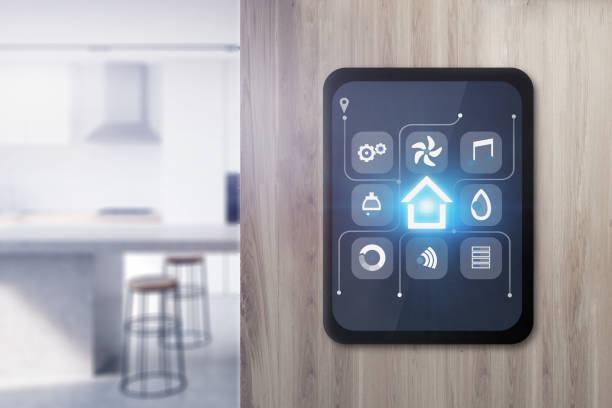 Smart home icons on tablet in kitchen Glowing smart home icons on tablet computer screen attached to wooden wall in blurred kitchen. Concept of automation and internet of things. 3d rendering illustration. smart thermostat stock pictures, royalty-free photos & images