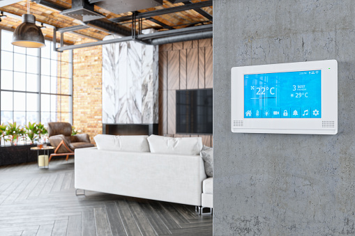 Interior of a modern luxury house with smart automation system.