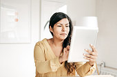 Woman controlling the home from digital tablet