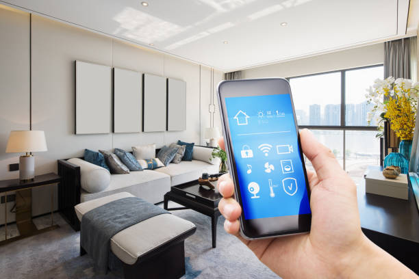 smart home system on mobile phone with background smart home system on mobile phone with background of modern living room home automation stock pictures, royalty-free photos & images