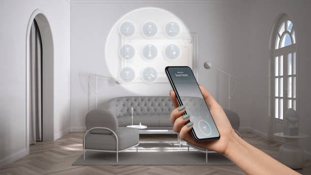 Smart home technology interface on phone app, augmented reality, internet of things, interior design of classic lounge with connected objects, woman hand holding remote control device stock photo