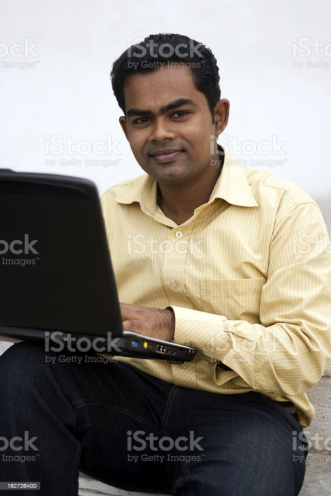Smart Indian Youth Working On Laptop royalty-free stock photo