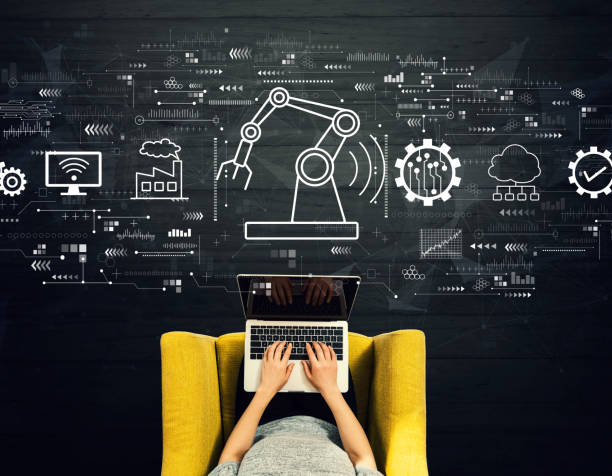 Smart industry concept with person using a laptop stock photo