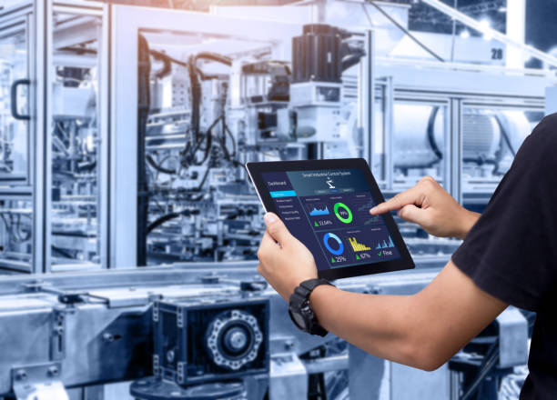 Smart industry control concept. Hands holding tablet on blurred automation machine as background manufacturing stock pictures, royalty-free photos & images